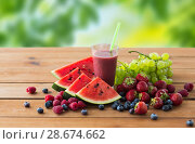 fruit and berry juice or smoothie on wooden table. Стоковое фото, фотограф Syda Productions / Фотобанк Лори
