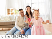 Купить «happy baby girl and parents at home», фото № 28674770, снято 7 марта 2018 г. (c) Syda Productions / Фотобанк Лори