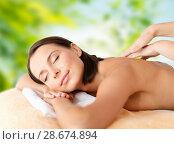 Купить «close up of beautiful woman having massage at spa», фото № 28674894, снято 25 июля 2013 г. (c) Syda Productions / Фотобанк Лори