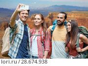 Купить «friends with backpack taking selfie by smartphone», фото № 28674938, снято 25 июля 2015 г. (c) Syda Productions / Фотобанк Лори
