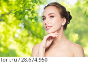beautiful young woman touching her face. Стоковое фото, фотограф Syda Productions / Фотобанк Лори