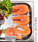 Купить «salmon fish fillet in metal tray on ice at grocery», фото № 28675002, снято 2 ноября 2016 г. (c) Syda Productions / Фотобанк Лори
