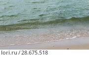 Купить «sea shore or ocean waves on beach», видеоролик № 28675518, снято 25 июня 2018 г. (c) Syda Productions / Фотобанк Лори