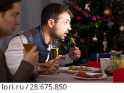 Couple celebrating New Year and watching tv at dinner. Стоковое фото, фотограф Яков Филимонов / Фотобанк Лори