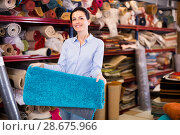 Купить «Woman customer shopping carpet in interior stor», фото № 28675966, снято 22 ноября 2017 г. (c) Яков Филимонов / Фотобанк Лори