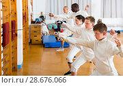 Купить «fencers athletes of different ages on training», фото № 28676066, снято 30 мая 2018 г. (c) Яков Филимонов / Фотобанк Лори