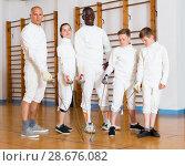 Купить «Portrait of mixed age group of athletes», фото № 28676082, снято 30 мая 2018 г. (c) Яков Филимонов / Фотобанк Лори