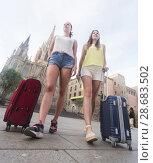 Купить «female tourists exploring old european city with baggage», фото № 28683502, снято 29 мая 2017 г. (c) Яков Филимонов / Фотобанк Лори
