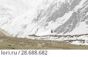 Купить «Rescue helicopter flying away after evacuation of mountain climbers», видеоролик № 28688682, снято 18 июня 2018 г. (c) Dzmitry Astapkovich / Фотобанк Лори