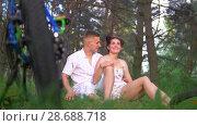 Купить «Speed bike on the grass in front of young couple have a rest after cycling in summer forest», видеоролик № 28688718, снято 18 июня 2019 г. (c) Константин Шишкин / Фотобанк Лори