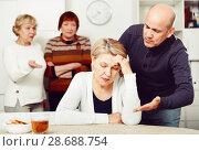 Купить «Mature female is sitting upset and man is apologizing», фото № 28688754, снято 16 декабря 2017 г. (c) Яков Филимонов / Фотобанк Лори