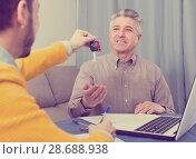 Купить «Mature man and manager contract car lease», фото № 28688938, снято 16 июля 2018 г. (c) Яков Филимонов / Фотобанк Лори