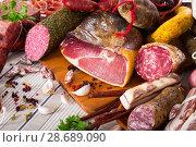Купить «Variety of meats on table», фото № 28689090, снято 15 декабря 2018 г. (c) Яков Филимонов / Фотобанк Лори