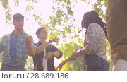 Купить «happy friends dancing at summer party in park», видеоролик № 28689186, снято 26 июня 2018 г. (c) Syda Productions / Фотобанк Лори