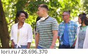Купить «happy international friends walking in park», видеоролик № 28696370, снято 25 июня 2018 г. (c) Syda Productions / Фотобанк Лори