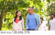 Купить «happy international friends walking in park», видеоролик № 28696378, снято 25 июня 2018 г. (c) Syda Productions / Фотобанк Лори