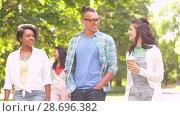 Купить «international friends with coffee walking in park», видеоролик № 28696382, снято 25 июня 2018 г. (c) Syda Productions / Фотобанк Лори