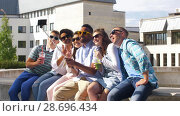 Купить «friends taking picture by on selfie stick in city», видеоролик № 28696434, снято 25 июня 2018 г. (c) Syda Productions / Фотобанк Лори