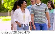 Купить «happy international friends walking in summer park», видеоролик № 28696470, снято 25 июня 2018 г. (c) Syda Productions / Фотобанк Лори