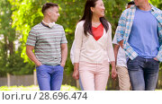 Купить «happy international friends walking in summer park», видеоролик № 28696474, снято 25 июня 2018 г. (c) Syda Productions / Фотобанк Лори