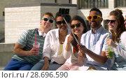 Купить «friends taking picture by selfie stick in city», видеоролик № 28696590, снято 25 июня 2018 г. (c) Syda Productions / Фотобанк Лори