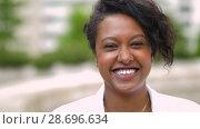 Купить «portrait of african american young woman outdoors», видеоролик № 28696634, снято 25 июня 2018 г. (c) Syda Productions / Фотобанк Лори