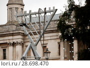 Купить «Workmen install Menorah in Trafalgar Square London for Chanukah - the Jewish Festival of Light Featuring: Atmosphere Where: London, United Kingdom When: 23 Dec 2016 Credit: WENN.com», фото № 28698470, снято 23 декабря 2016 г. (c) age Fotostock / Фотобанк Лори