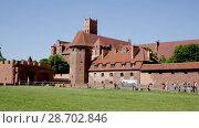 Купить «Malbork Castle is famous landmark of Poland outdoor.», видеоролик № 28702846, снято 13 мая 2018 г. (c) Яков Филимонов / Фотобанк Лори
