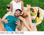 Купить «Adult male is resting on the lap of woman», фото № 28703342, снято 10 августа 2017 г. (c) Яков Филимонов / Фотобанк Лори