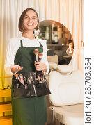 Купить «woman visagiste standing with brushes», фото № 28703354, снято 24 сентября 2018 г. (c) Яков Филимонов / Фотобанк Лори