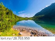 Купить «Lake Morskoye Oko, surrounded by forests in the Tatra Mountains, Poland», фото № 28703950, снято 18 августа 2017 г. (c) Константин Лабунский / Фотобанк Лори