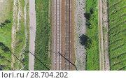 Купить «Electrified railway track. The camera moves along the rail direction.», видеоролик № 28704202, снято 16 июня 2018 г. (c) Андрей Радченко / Фотобанк Лори