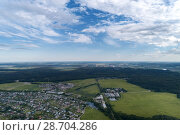 Купить «Aerial view of wheat fields, meadow, forest and village in rural Russia.», фото № 28704286, снято 11 июня 2018 г. (c) Андрей Радченко / Фотобанк Лори