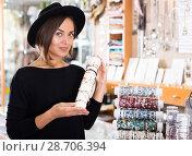 Купить «woman in hat choosing stylish bracelets», фото № 28706394, снято 16 октября 2017 г. (c) Яков Филимонов / Фотобанк Лори