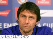 Купить «Chelsea manager Antonio Conte addressing a press conference at the Chelsea training facility in Cobham, Surrey, ahead of the club's FA Cup match against...», фото № 28710670, снято 6 января 2017 г. (c) age Fotostock / Фотобанк Лори