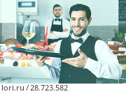 Купить «Waiter holding tray with seafood dishes at fish restaurant again», фото № 28723582, снято 26 января 2018 г. (c) Яков Филимонов / Фотобанк Лори
