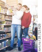 Купить «Customers purchasing tinned food at canned section», фото № 28723626, снято 14 марта 2017 г. (c) Яков Филимонов / Фотобанк Лори