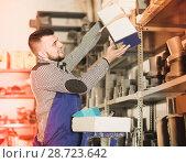 Купить «Attractive man worker looking through sanitary drain pipes», фото № 28723642, снято 15 марта 2017 г. (c) Яков Филимонов / Фотобанк Лори