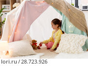 Купить «little girl playing tea party in kids tent at home», фото № 28723926, снято 18 февраля 2018 г. (c) Syda Productions / Фотобанк Лори