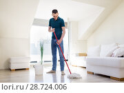 Купить «man with mop and bucket cleaning floor at home», фото № 28724006, снято 10 мая 2018 г. (c) Syda Productions / Фотобанк Лори