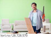 Купить «Woodworker working in his workshop», фото № 28728570, снято 15 мая 2018 г. (c) Elnur / Фотобанк Лори