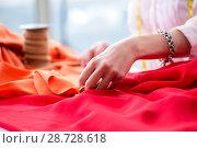 Купить «Woman tailor working on new dress designs», фото № 28728618, снято 13 апреля 2018 г. (c) Elnur / Фотобанк Лори