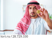 Купить «Arab man with bitcoin in cryptocurrency mining concept», фото № 28729330, снято 24 апреля 2018 г. (c) Elnur / Фотобанк Лори