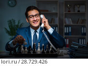 Купить «Businessman playing chess in strategy concept», фото № 28729426, снято 9 октября 2017 г. (c) Elnur / Фотобанк Лори