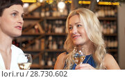 Купить «happy women drinking wine at bar or restaurant», видеоролик № 28730602, снято 4 июля 2018 г. (c) Syda Productions / Фотобанк Лори