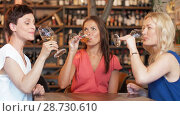 Купить «happy women drinking wine at bar or restaurant», видеоролик № 28730610, снято 4 июля 2018 г. (c) Syda Productions / Фотобанк Лори
