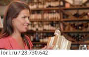 Купить «women giving present to friend at wine bar», видеоролик № 28730642, снято 4 июля 2018 г. (c) Syda Productions / Фотобанк Лори