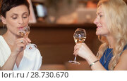 Купить «happy women drinking wine at bar or restaurant», видеоролик № 28730670, снято 4 июля 2018 г. (c) Syda Productions / Фотобанк Лори