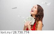 Купить «happy woman in red dress with us dollar money», видеоролик № 28730774, снято 9 июля 2018 г. (c) Syda Productions / Фотобанк Лори
