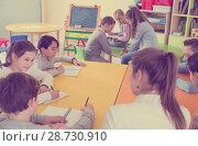 Купить «Teacher and pupils working in classroom», фото № 28730910, снято 28 января 2018 г. (c) Яков Филимонов / Фотобанк Лори